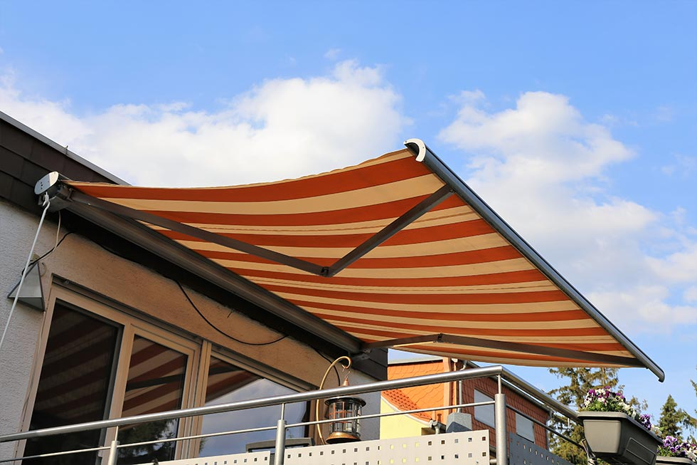 a retractable awning shades a deck