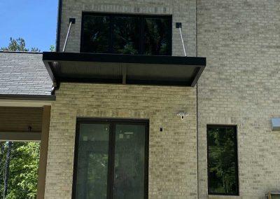 residential grey brick awning black
