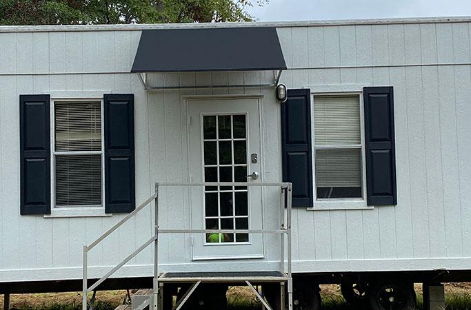 black awning mobile unit